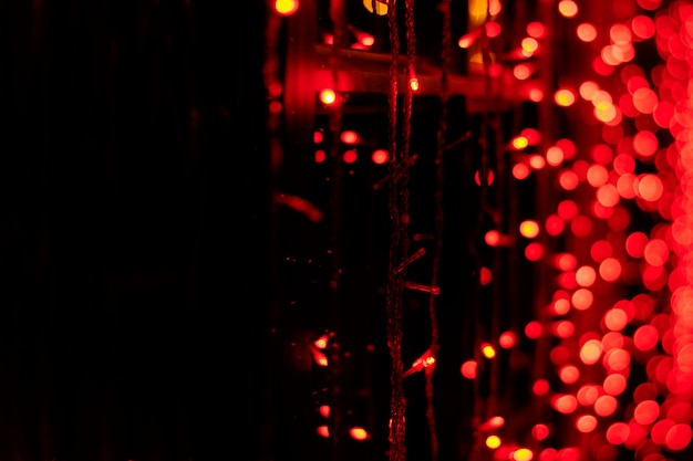 Red garland, natural bokeh on black