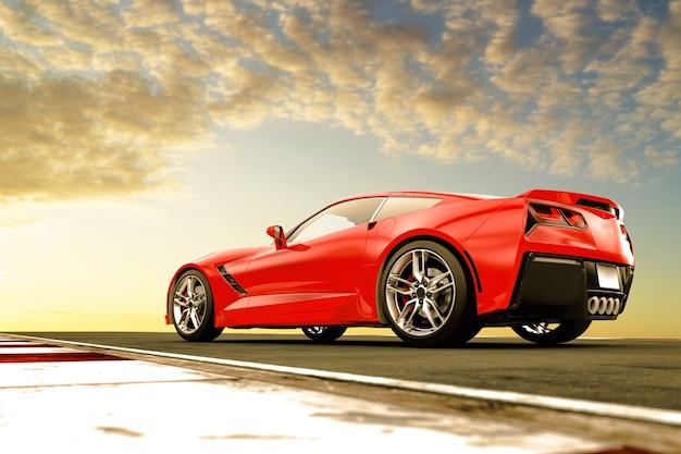 Красный универсальный спортивный автомобиль на закате