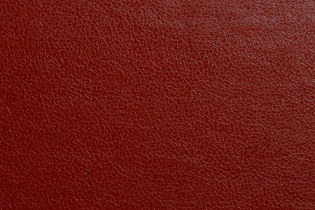 赤い本革。デザインの背景。高品質の写真