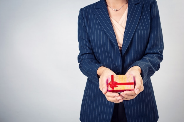 Red gift box from business woman