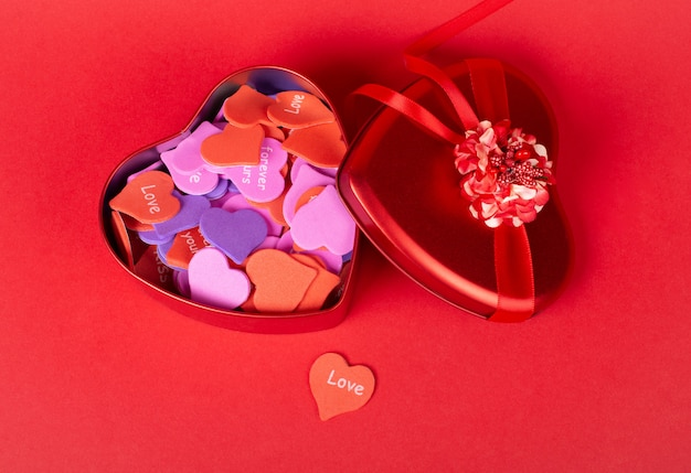 Red gift box and a handmade paper heart