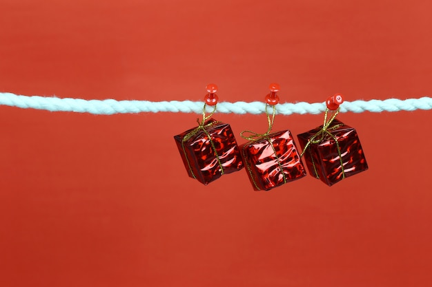 Red gift box hang on the clothesline.