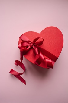 Red gift box heart shape with red ribbon