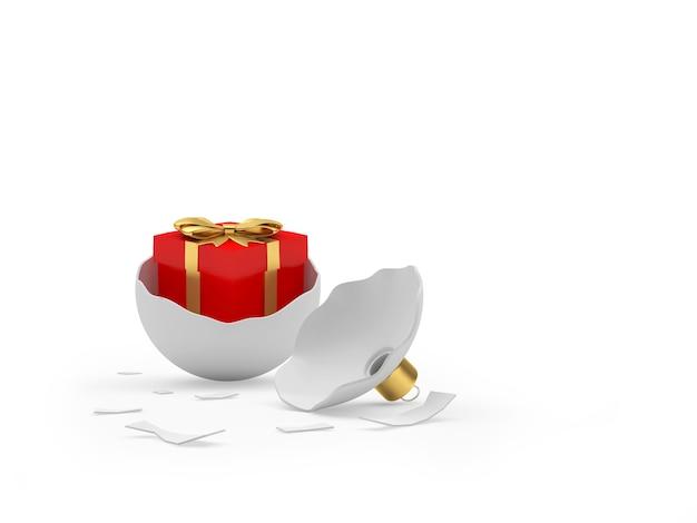 Красная подарочная коробка в сломанном елочном шаре