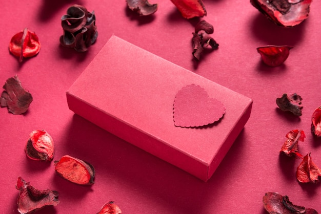 Red gift box and paper hearts, valentine day present