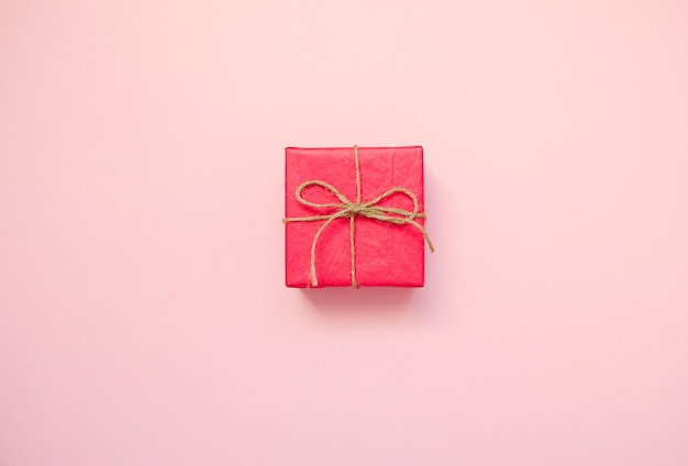 Red gift box on pink background.