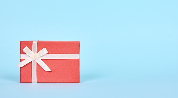 Red gift box with ribbon. isolated.