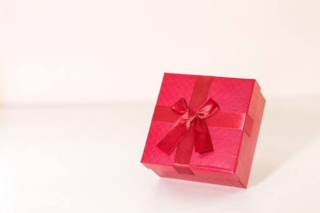 Red gift box on wooden plank. concept for valentine day.