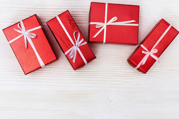 Red gift boxes top view. copy space. top view. presents for valentines day, womans day, anniversary or party.