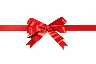 Red gift ribbon and bow isolated on white.