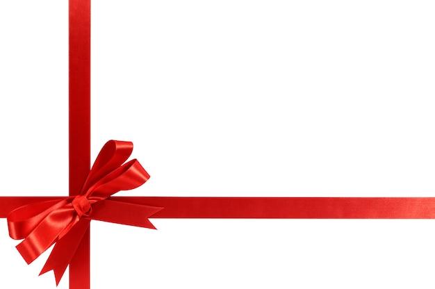 Red gift ribbon bow horizontal corner cross shape isolated on white.