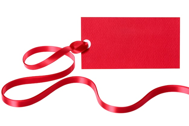 Red gift tag or label with ribbon isolated on white background