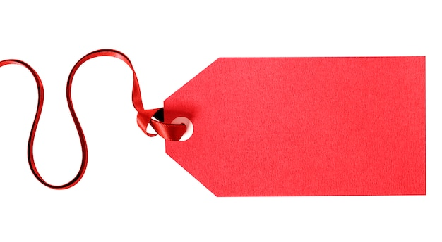Red gift tag tied with red ribbon isolated on white