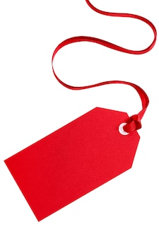 Red gift tag with ribbon isolated on white.