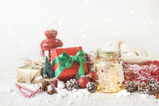Red gift with a glass jar with lights