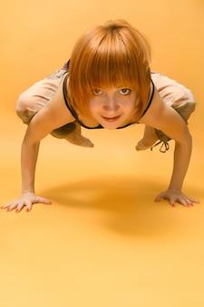 Red girl performing yoga asana