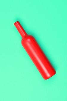 緑地に赤いガラス瓶