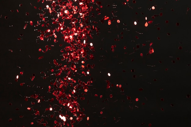 Red glitter on black background