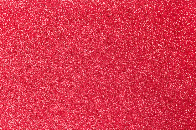 Red glitter shiny texture for christmas, celebration concept.