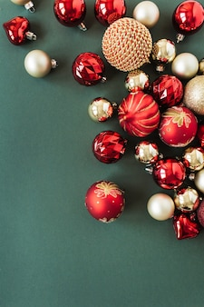 Red and gold christmas baubles balls on green