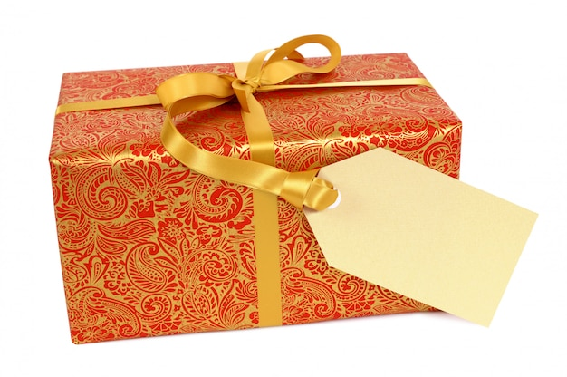 Red and gold gift with ribbon and gift tag label isolated on white background