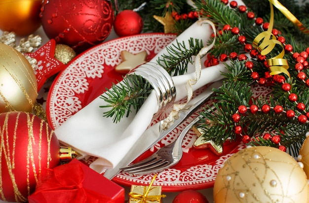Red and golden festive table setting isolated