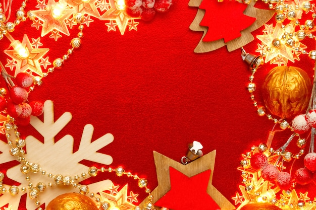 Red and golden  with christmas decorations and garlands. abstract xmas pattern. frame, border.