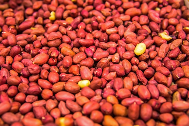 Red grain peanut on the entire background