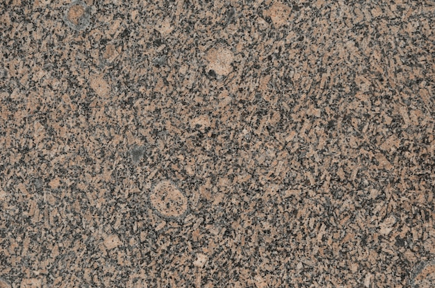 Red granite slab, surface with grunge texture