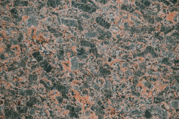Red granite texture close up