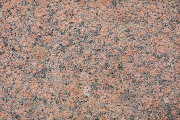Red granite wall as a texture background.
