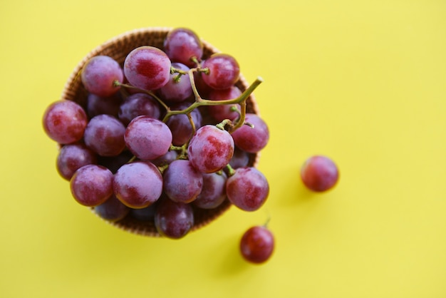 Red grape bunch in basket - fresh grape fruit on the table