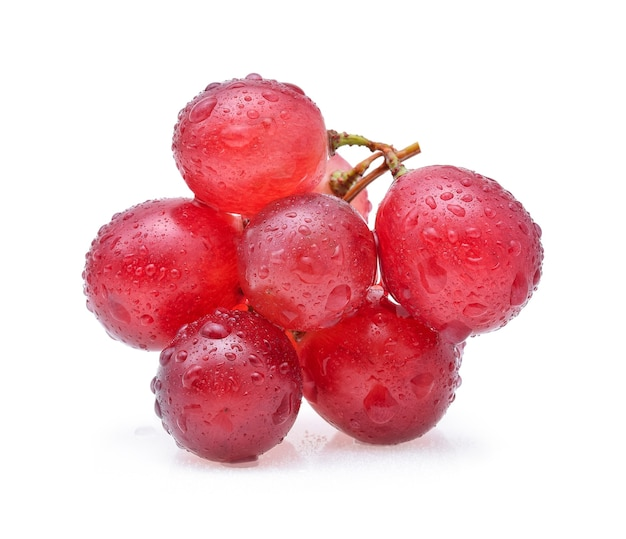 Red grapes and water drops isolated on white background