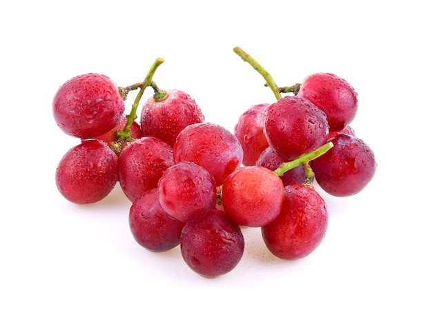 Red grapes with water drops isolated on white background