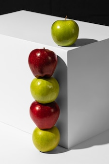 Red and green apples next to podium