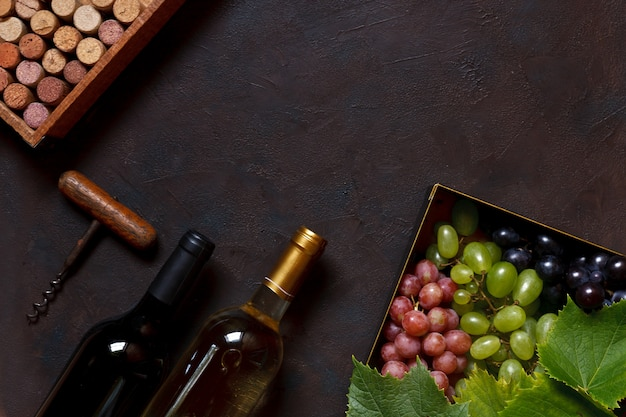 Red, green and  blue grapes with leaves in metal box