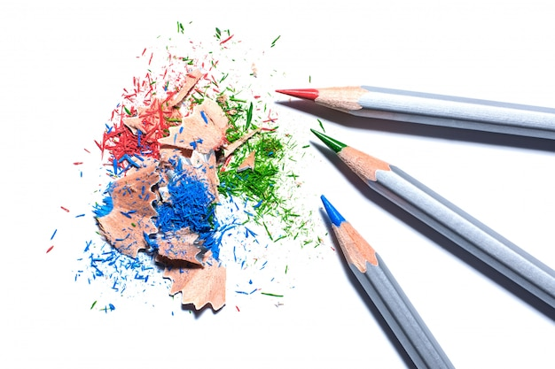 Red, green and blue pencil with shravings isolated