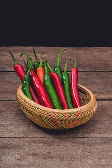 Red and green chili on wooden table background