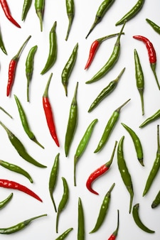 Red and green hot chilli pepper on white background