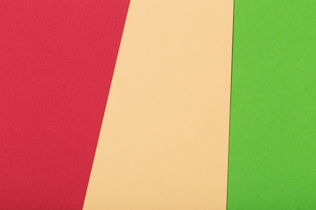 Red, green and light beige cardboard sheets geometrical background