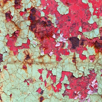Red and green paint on metal surface