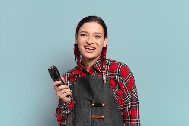 赤い髪のクールな女性の美容師の概念