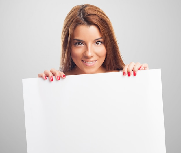 Red hair woman holding blank