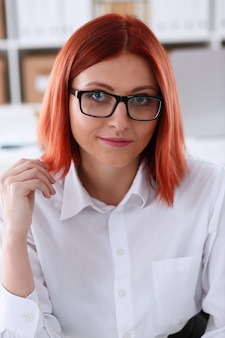 Red haired business woman with glasses