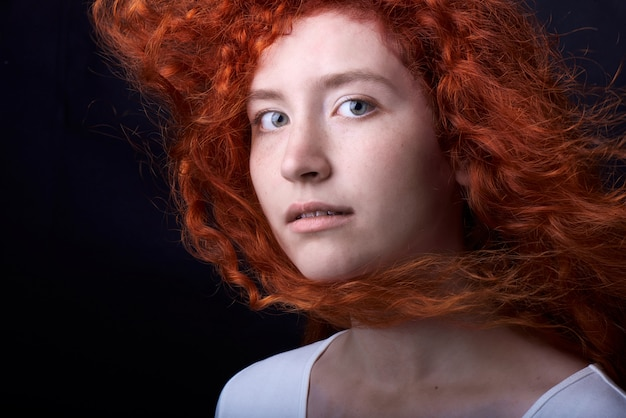 Red haired girl on black backdrop