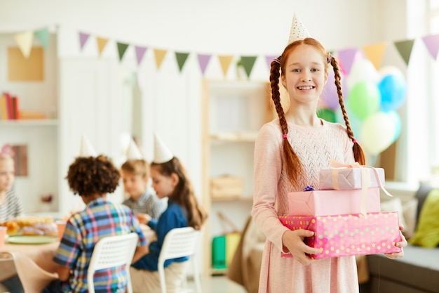 Red haired girl holding birthday presents