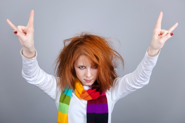 Red-haired rock girl in scarf.