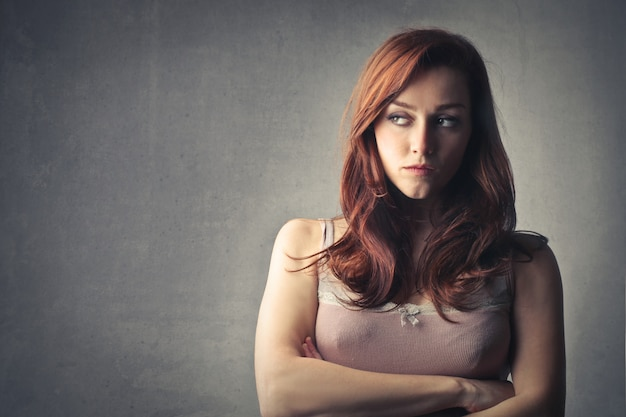 Red haired woman looking huffy