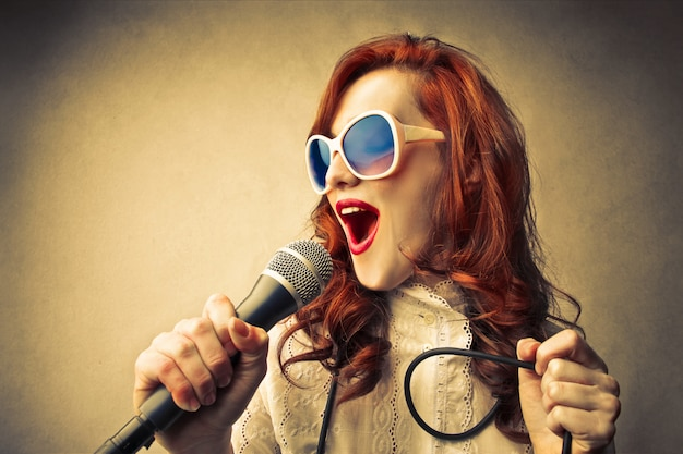 Red-haired woman singing