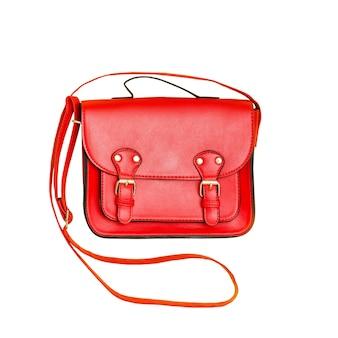 赤いハンドバッグ。ファッショナブルなコンセプト。分離されました。白い表面